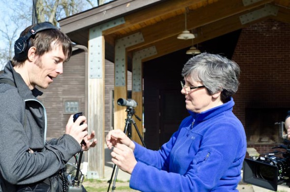 Bridget Stutchbury passes a Purple martin to location sound recordist Jason Milligan